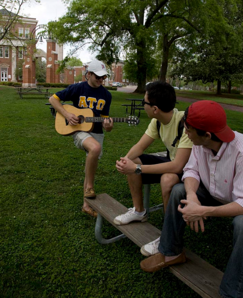 student playing guitar