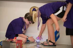 two students interact at coding camp