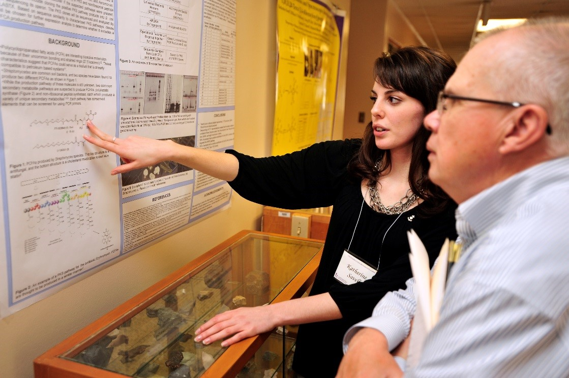 Kate presents her research to Dr. Hamilton in Undergraduate Research Day 2014