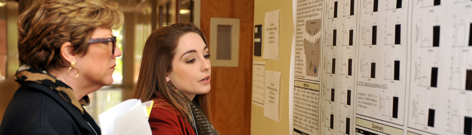 Student presenting her poster research to Dean Mary Beth Armstrong