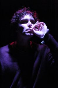 A man smokes a cigarette in a scene from Eurydice