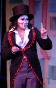 female character gestures in a scene from Scapin