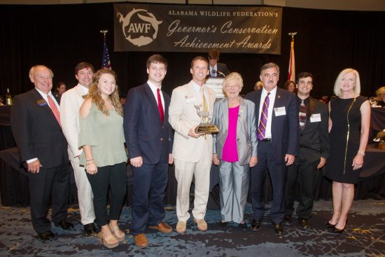 L to R: Presenting the awards were Horace Horn with PowerSouth Energy; Angus Cooper, III, AWF President; Governor Kay Ivey and Susan Comensky with Alabama Power Company. Accepting on behalf of the University of Montevallo were Hannah Garner, Ryan Baker, Outdoor Scholars Program Director William Crawford, UM President Dr. John Stewart and Grant Deavers.