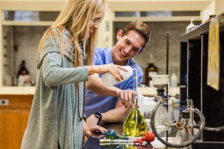 Two students enjoying chemistry class