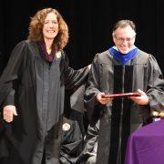Dr. Herron accepts his award