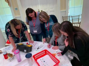 UM alumnae Holly Jackson '11 and Amber Broadhead '09 organized a summer teaching summit at American Village in Montevallo.