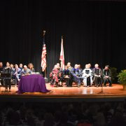 Participants sit on the stage during the 2018 Founders' Day ceremony.