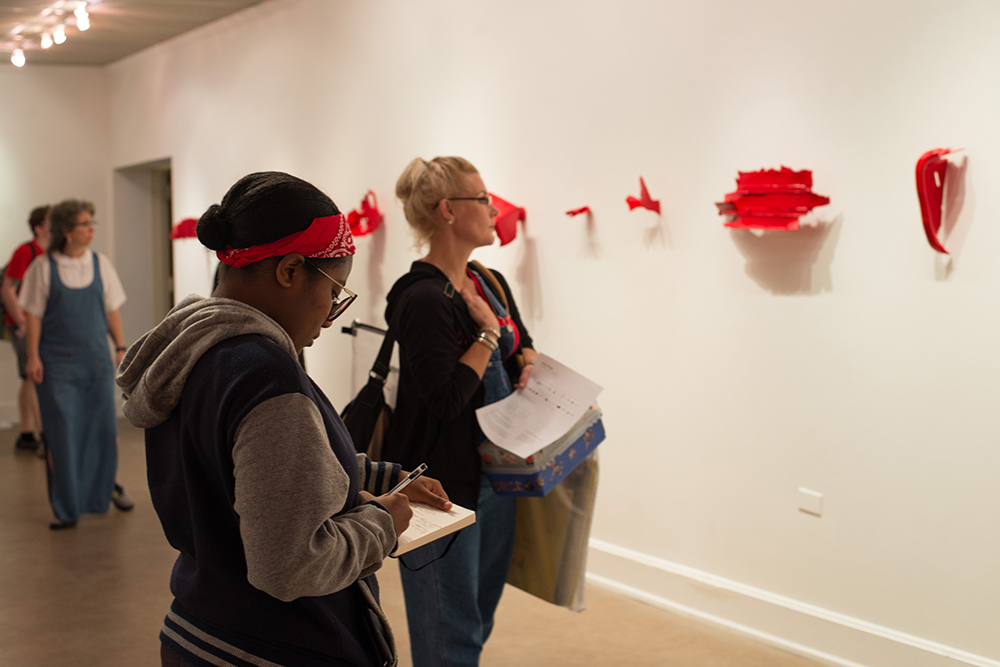 Montevallo students view an art display.
