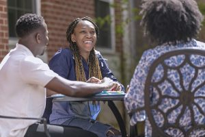Montevallo students studying together on outdoor patio.