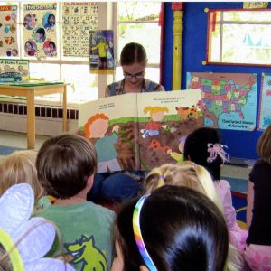 A teacher at the UM Child Study Center reads to students.