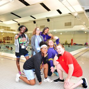Youth from the Montevallo community pose for a photo at the Student Activity Center natatorium.
