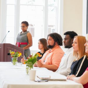 Panelists at a UM Inclusion conference listen to an audience member.