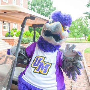 Freddie the Falcon on a golf cart